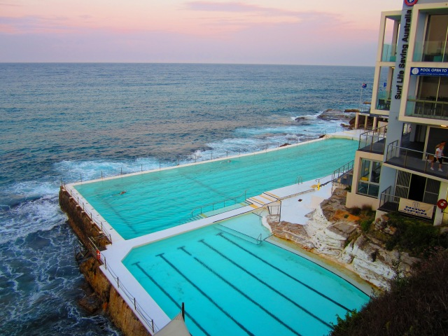 Bondi's outdoor, ocean-filled lap pool at sunset